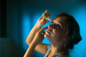 Woman Putting in Eye Drops In Colorado Springs, CO
