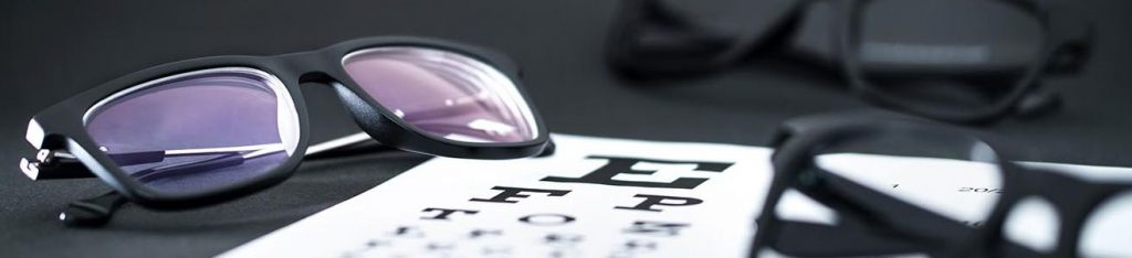 Glasses On Eye Sight Test Chart exam banner 1318x300