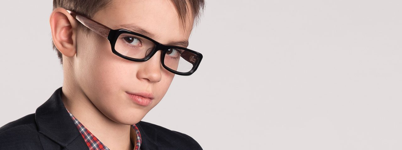 Boy wearing eyeglasses after eye exam