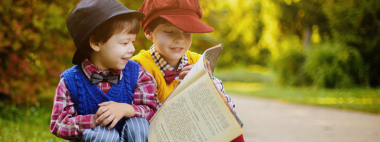 Children Reading Newspaper Outside 1280×480