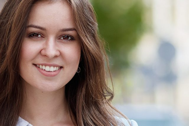 Girl Smiling Brown Hair with dry eyes