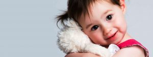 Little Girl Hugging Teddy 1280x480