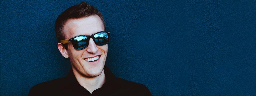 Man Sunglasses Blue Background 1280×480