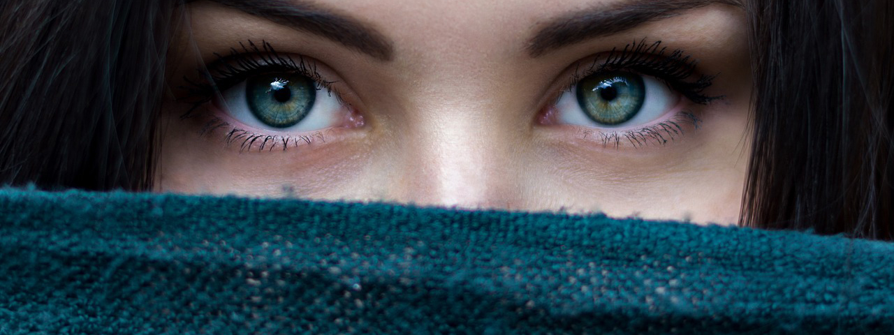 Woman Pretty Eyes, Long Eyelashes wearing Sweater