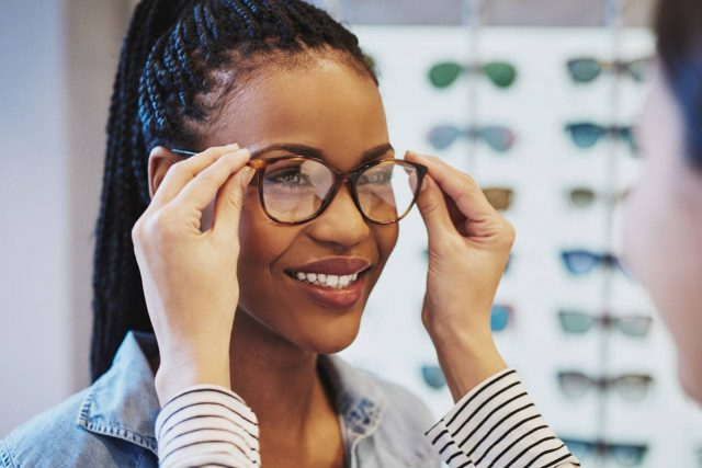 Woman-Trying-on-Glasses-st.-louis-mo