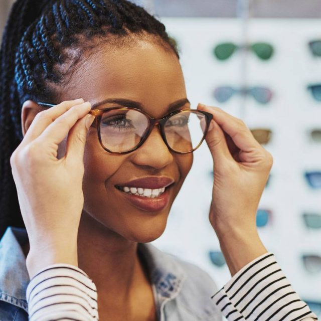 African American Woman Trying on Glasses in Dartmouth