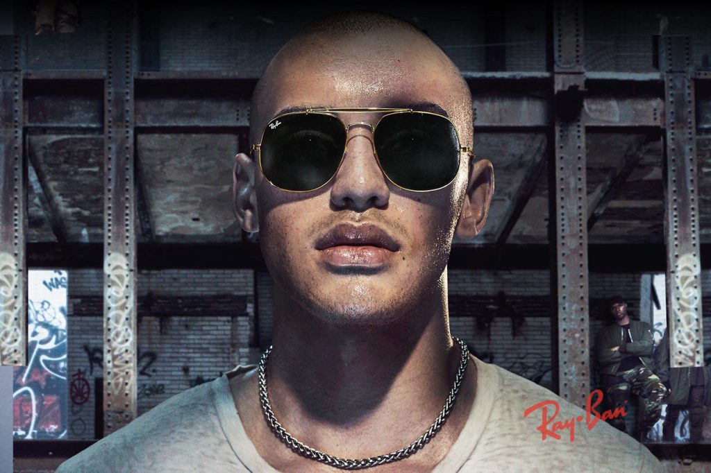 Ray Ban brand glasses on tough guy in warehouse