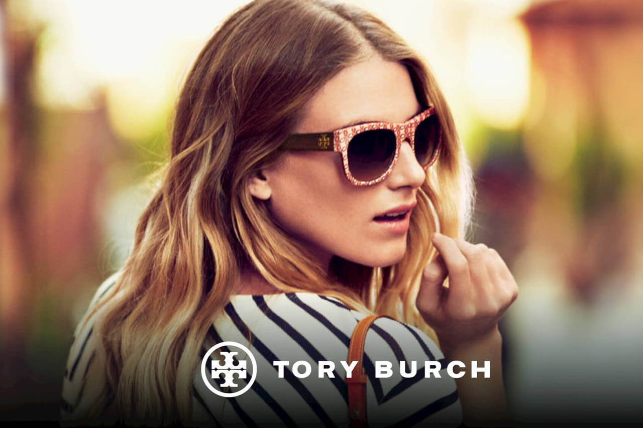 Tory Burch brand sunglasses on woman looking back