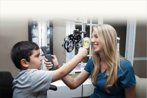 Doctor and child having eye exam with Care tonometer in Frisco, Breckenridge and Silverthorne, CO