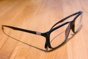 Eyeglasses brown desk