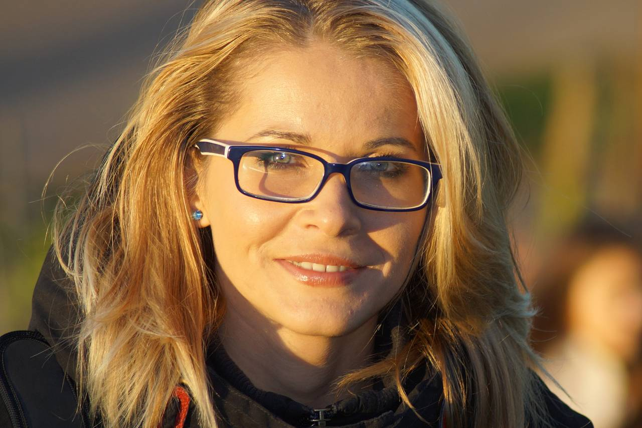 Blond Woman Glasses Satisfied1280x853