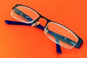Blue Glasses Orange Background, Optometrist, Eye Exam, Katy, TX