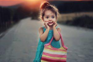 Cute Female Child With Handbag