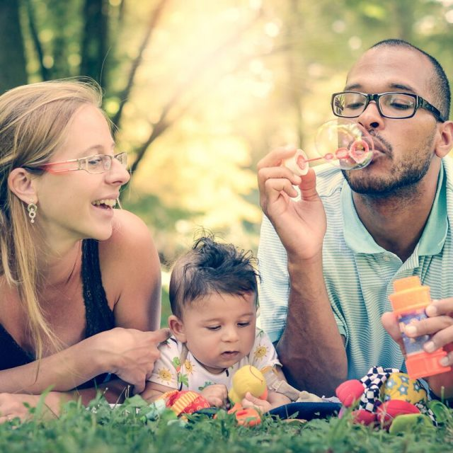 Interracial Family Wearing Glasses Blowing Bubbles 640X640