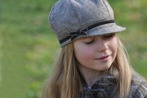 Child in Grey Hat was screened for eye disease and found to be healthy