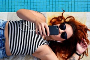 female redhead lying down sunglasses
