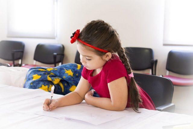Female Child Doing Schoolwork 1280x853
