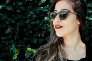 girl sunglasses greenery | LASIK treatment in Coronado, CA
