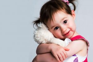 Little Girl Hugging Teddy 1280x853