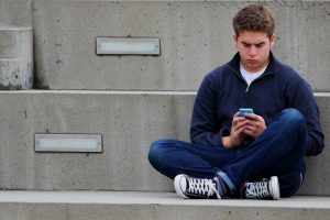 Male Teen Texting in Ogden, UT