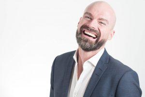 Man Wearing Suit Laughing