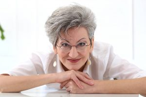 Senior Woman Smiling Glasses 1280x853