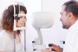 Eye care, woman receiving eye exam in Spring, TX