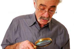 Senior Man Magnifying Glass