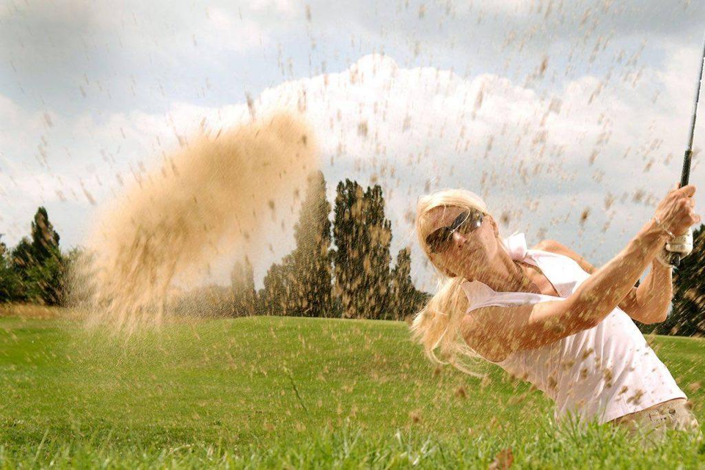 Sport golf sand woman