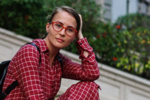 Optometsirt, Woman Wearing Eyeglasses in Maryland Heights, MO.