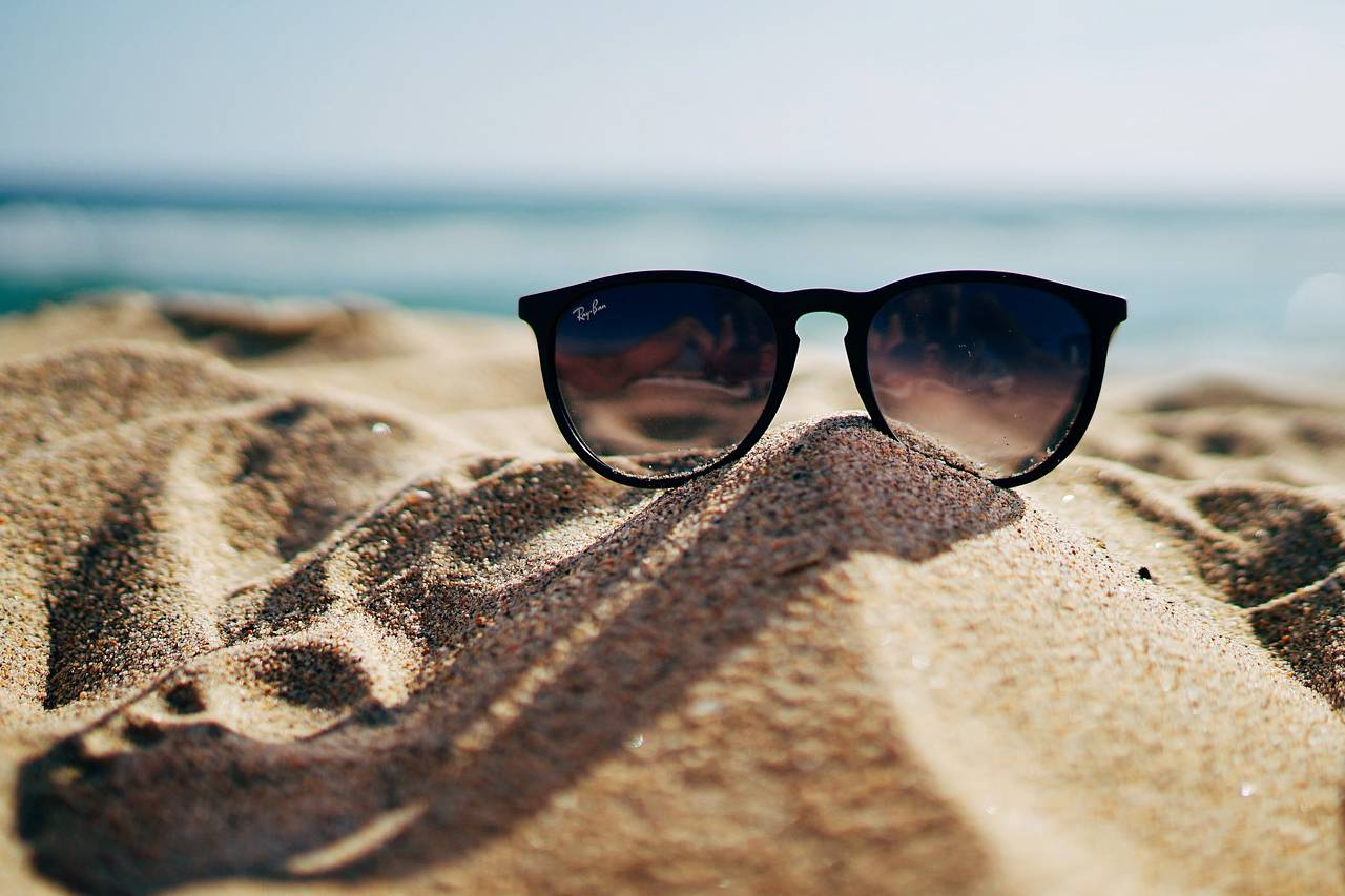 Sunglasses Beach Sand Pile 1280x853