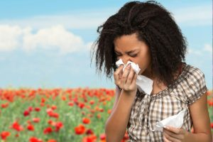 Woman Flowers Sneezing Allergies in Olathe, KS