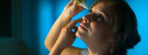 Woman Putting in Eye Drops, eye care, Frisco, Breckenridge and Silverthorne, CO