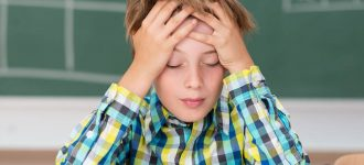 Young-Boy-Concentrating-1280x853-330x150