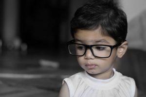 Young Child Big Glasses