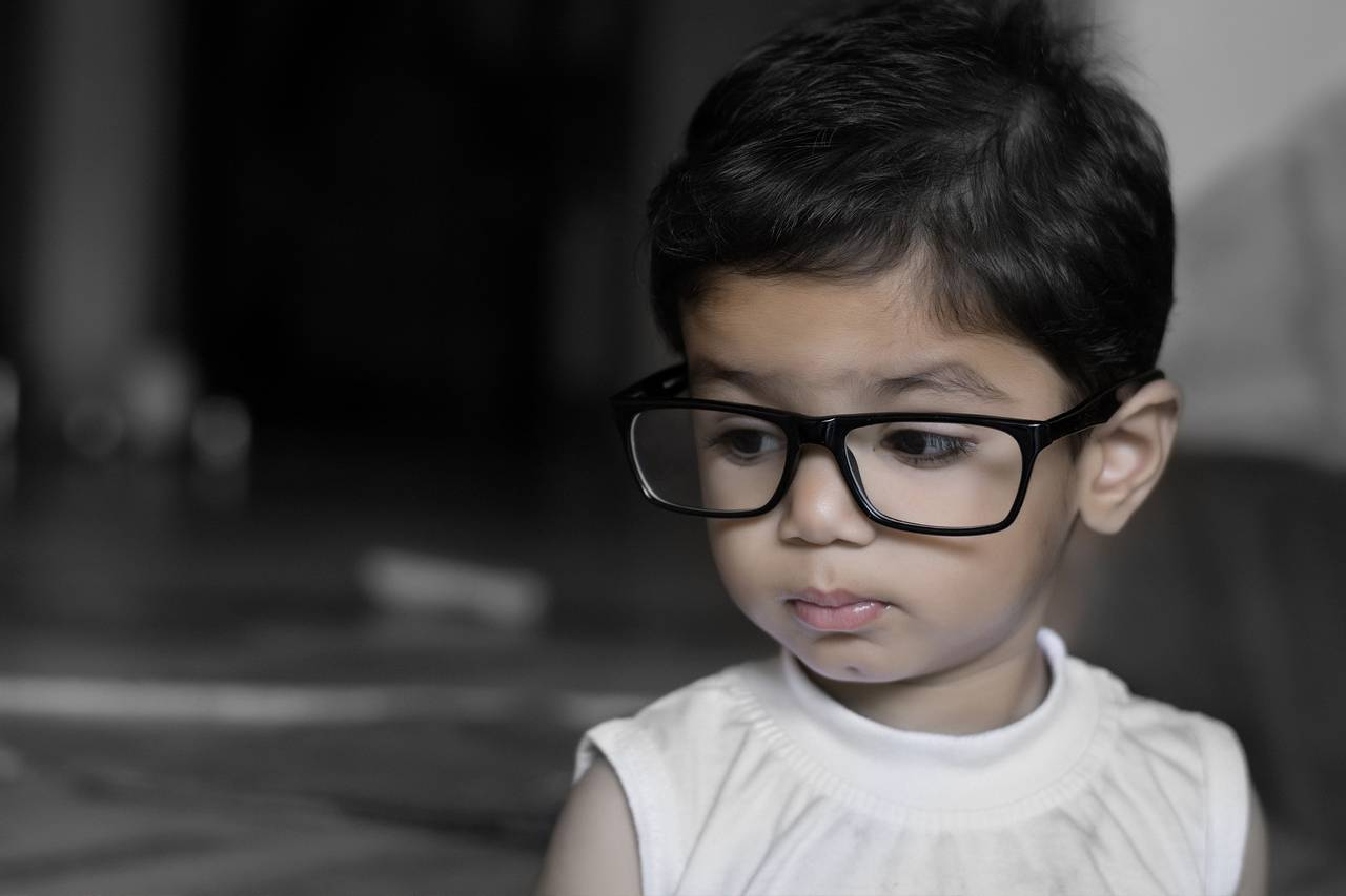Young Child Big Glasses 1280x853