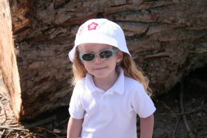 child wearing sunglasses | River Oaks Family Optometry