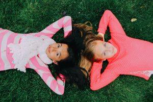 Girls Laying on Grass 1280x853
