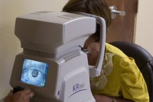 autorefractor woman exam - Stewart Family Eye Care Greer, SC, 29651