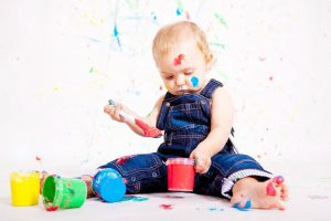 baby painting colorful | River Oaks Family Optometry