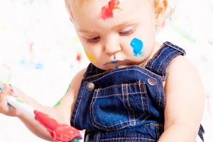 baby painting colorful closeup