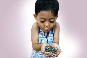 boy holding marbles, eye doctor in Fairfax VA