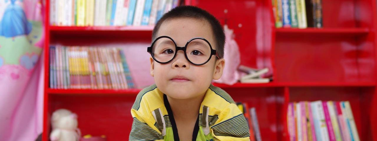 boy wearing glasses at Whitby Vision Care