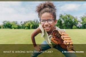 girl wearing eyeglasses, playing baseball