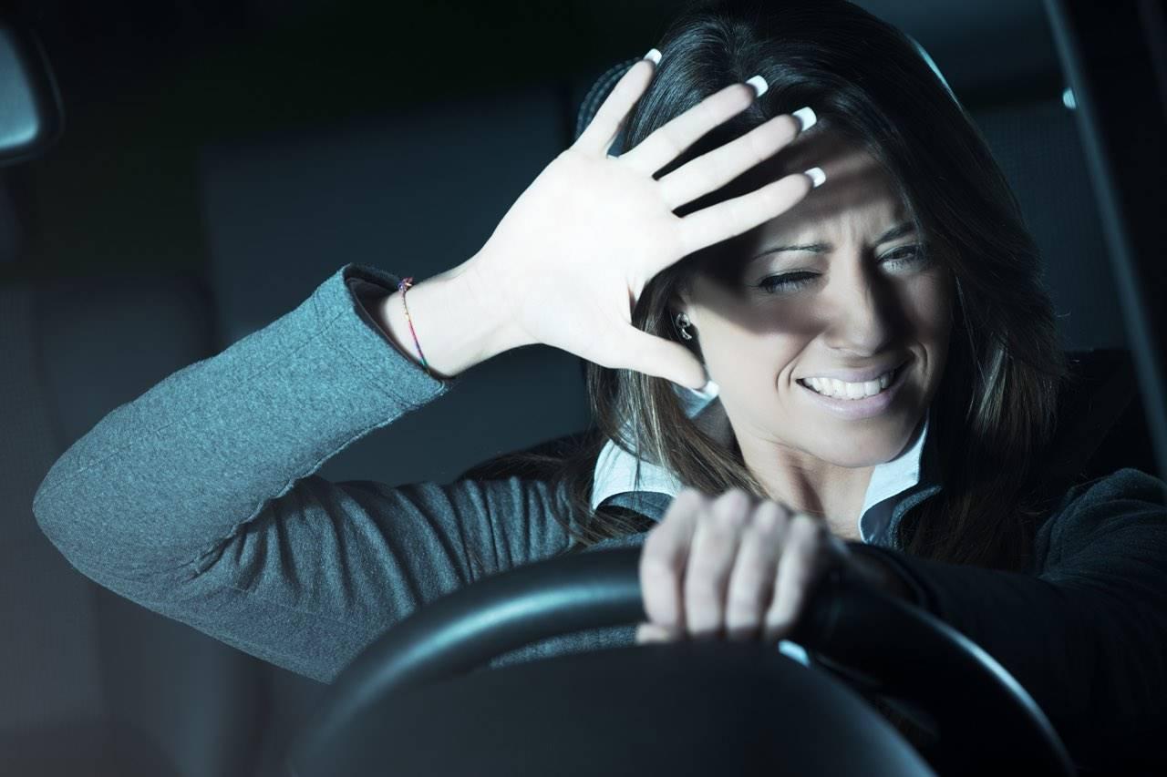 woman shielding eyes from light