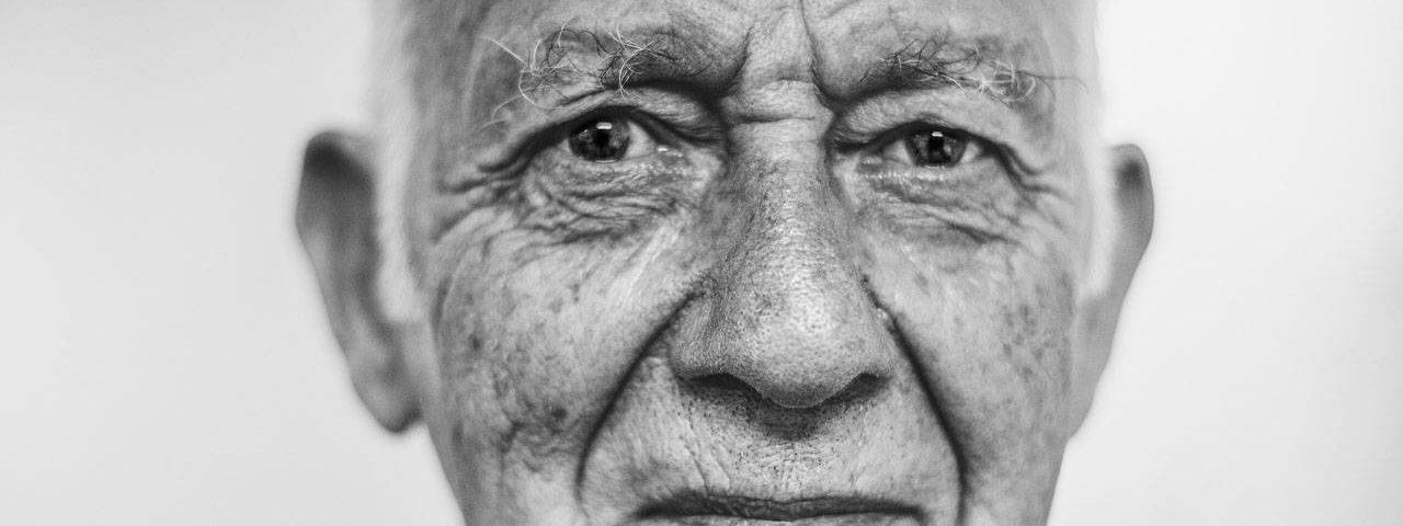eyes senior man caucasian bw 1280x480