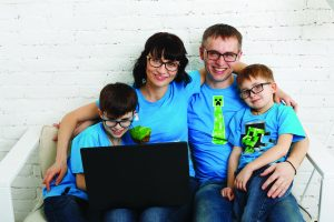 family wearing glasses at computer