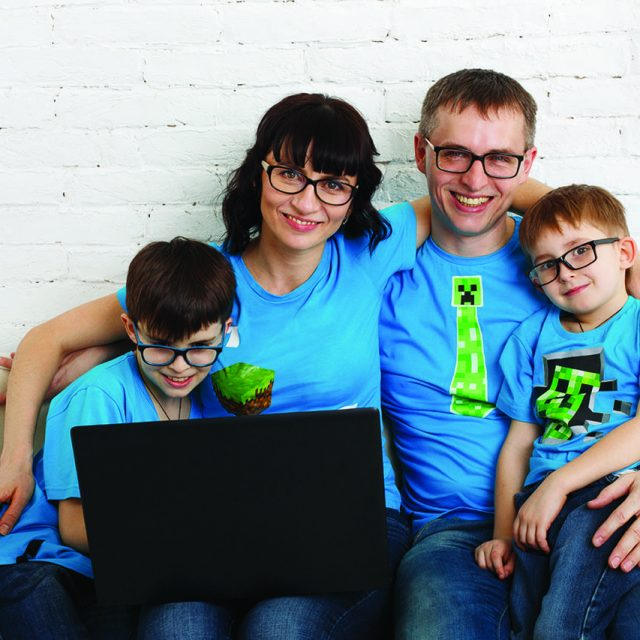 hipster family wearing eyeglasses and looking at computer