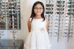 girl white dress new glasses display wall