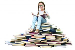 kid on book pile background